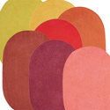Reversible Warm Colors Oval Chenille Rug